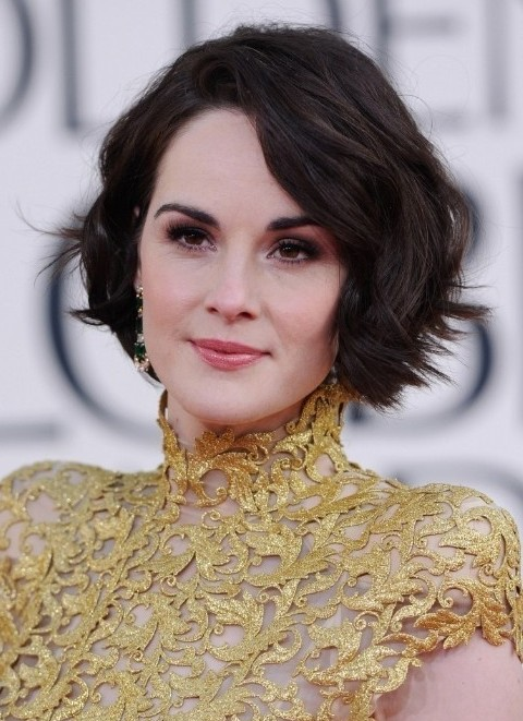 The charming layered hairstyle has soft curls added throughout the mid