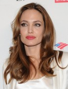 Angelina Jolie Hair Styles: 2014 Long Brown Polished Curly Hair