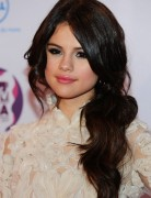 Selena Gomez Hairstyles: Low Ponytail with Side Part