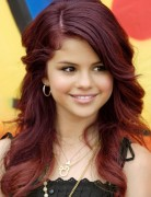 Selena Gomez Hairstyles: Red Long Curly Hairstyle
