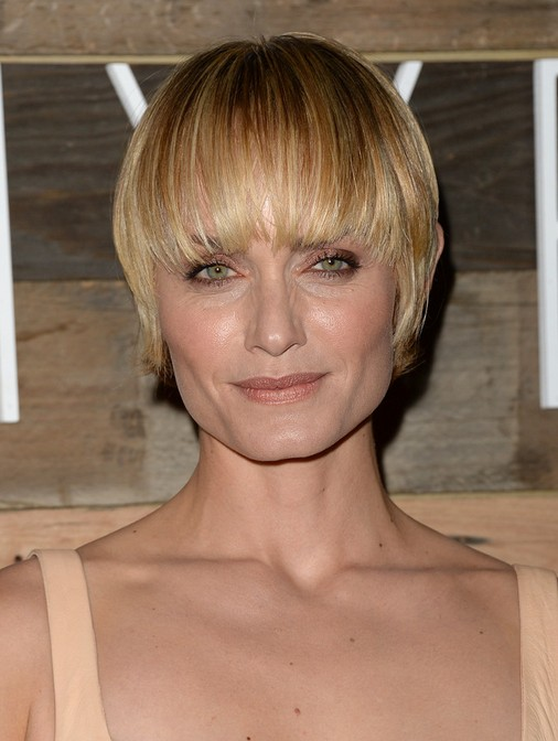 Short Haircuts for Older Women: Amber Valletta Layered Hairstyle with Blunt Bangs
