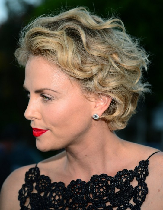 Celebrity Short Haircuts: Charlize Theron Short Curls Side View