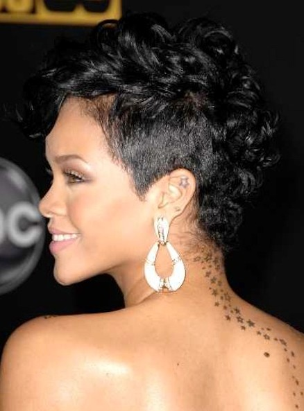 Rihanna Short Hairstyle: Black Pixie Haircut with Curly Hair