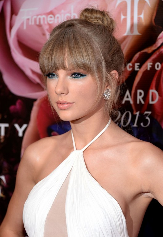 Taylor Swift Classic Bun: Updo Hairstyles with Bangs