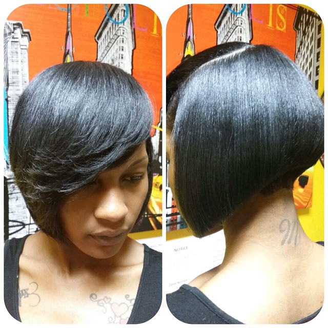 Dark Angled Bob Hairstyle with bangs for black women
