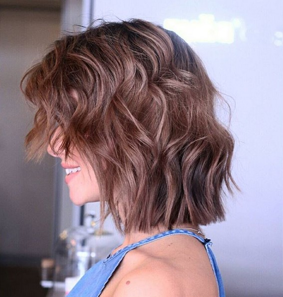 medium choppy bob haircut with waves brunette