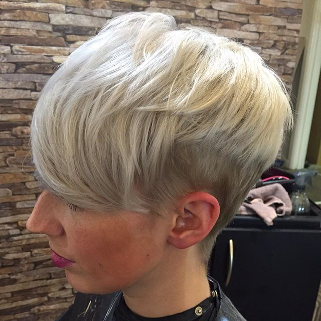 side view of short blonde pixie cut