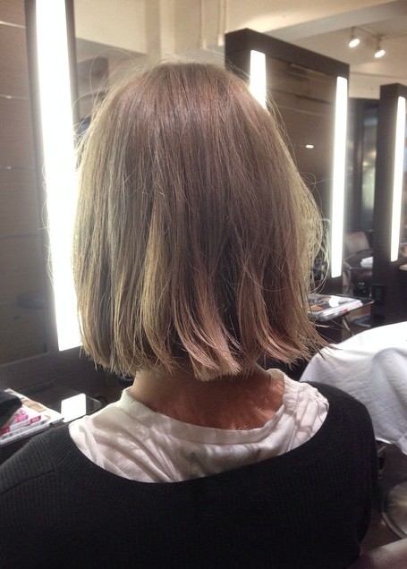 Back view of simple easy medium bob hairstyle for girls