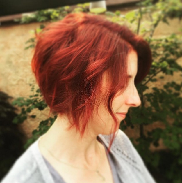 Redhead - short red messy curly angled bob hairstyle