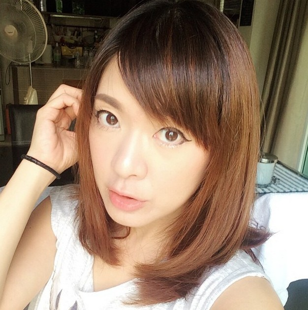 Sweet medium omrbe bob hairstyle with side bangs for Asian girls - Thailand