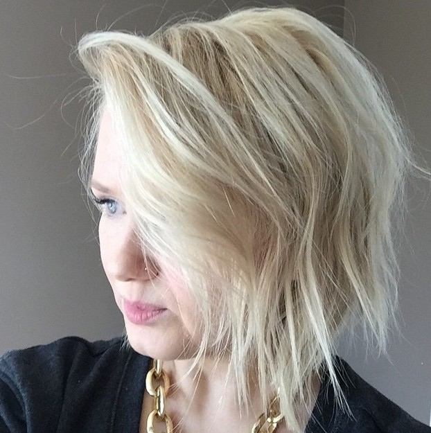 trendy choppy bob hairstyle with bangs for fine thin hair